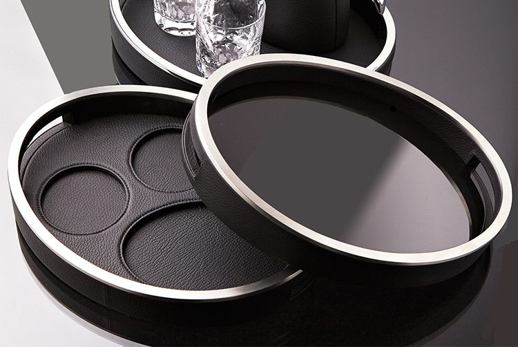 a black leather serving tray with a water jug and glass set on top