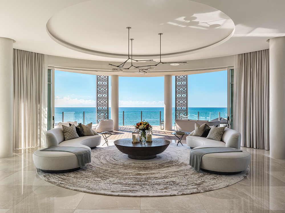 a reception room with a sea view and lots of luxury accessories