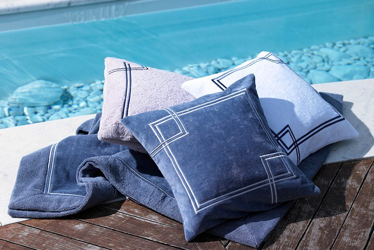 blue and grey exterior towels and cushions next to a pool