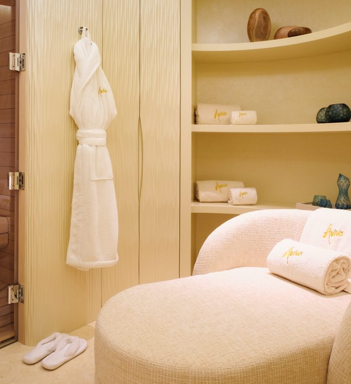 a superyacht's spa area with luxury bathrobes, slippers and towels