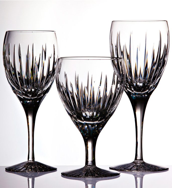 a white wine, red wine and water crystal class with hand cut lines in the glass