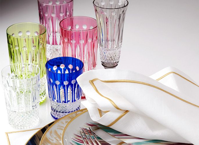 multi-coloured crystal glasses in green, blue and pink and purple