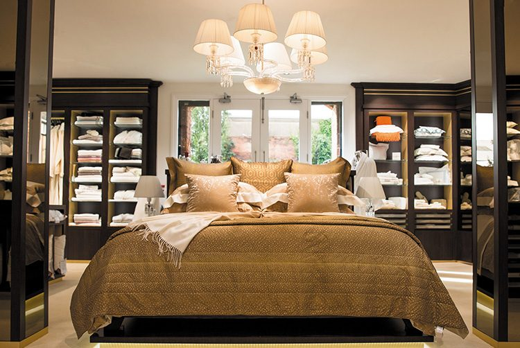 the stunning gold bed and chandelier in Glancy Fawcett's showroom