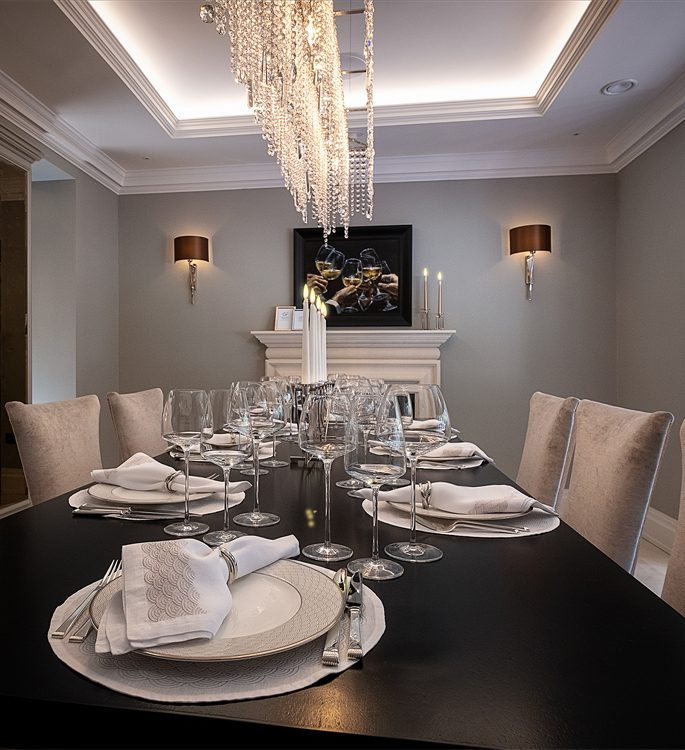 a dining room in a luxury house with beautiful tableware
