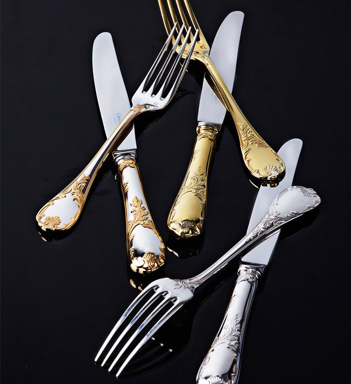 ornate gold cutlery with a floral pattern