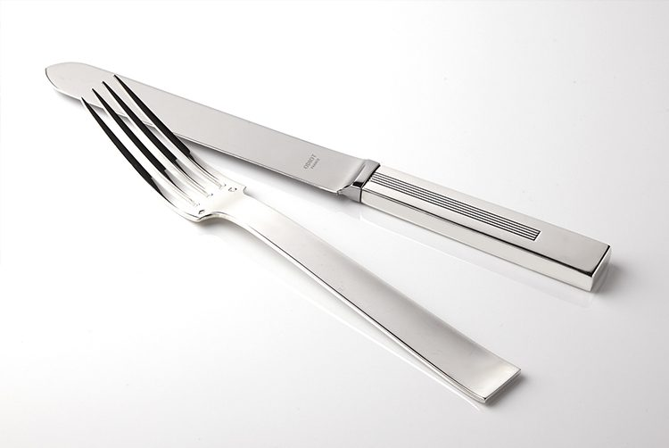 silver modern cutlery in detail with square handles