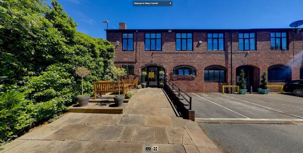 a screenshot from Glancy Fawcett's 360 VR tour showing the outside of the builidng
