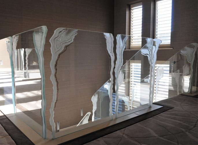 architectural glass staircase with floor to ceiling windows