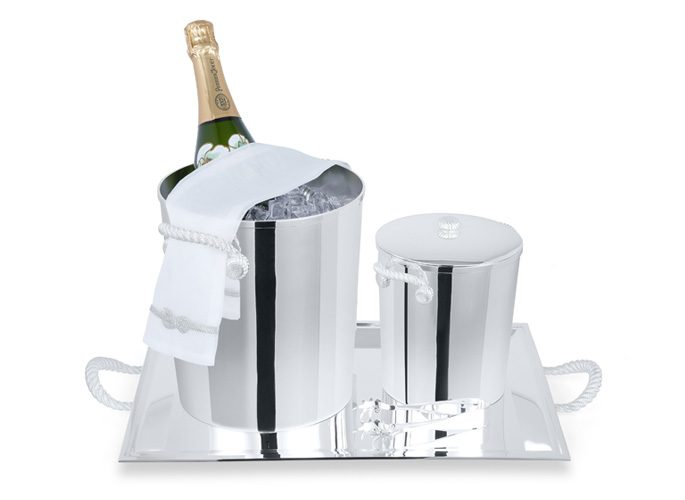a sterling silver champagne and ice bucket with delicate serving table linen