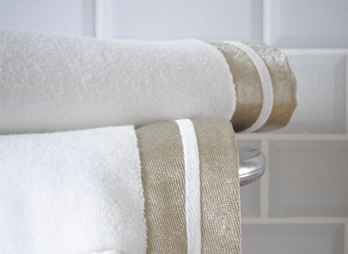modern white luxury bathroom towels with  two gold fabric borders