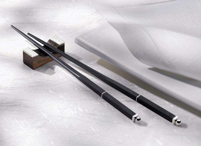 black chopsticks with a silver end and detailing