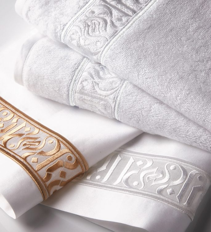 personalised towel with a middle eastern pattern in gold and silver embroidery