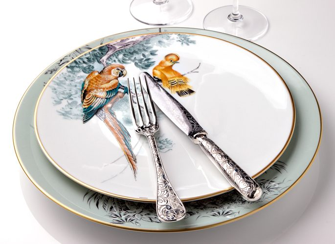 hermes porcelain plate with intricate decorative detail such as parrots in trees
