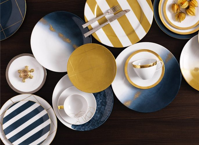 birdseye view of bright yellow and blue stripy porcelain plates
