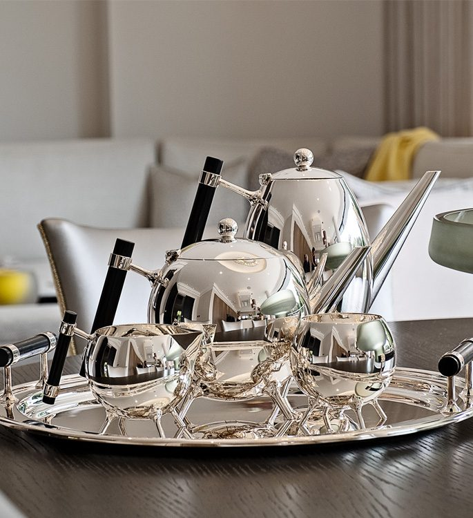 a sterling silver Christopher Dresser inspired tea set