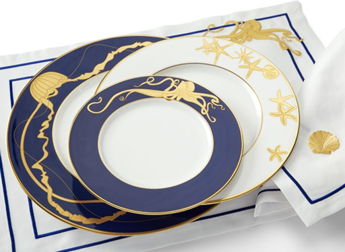 porcelain and matching table linen with gold sea creatures and blue embroidery