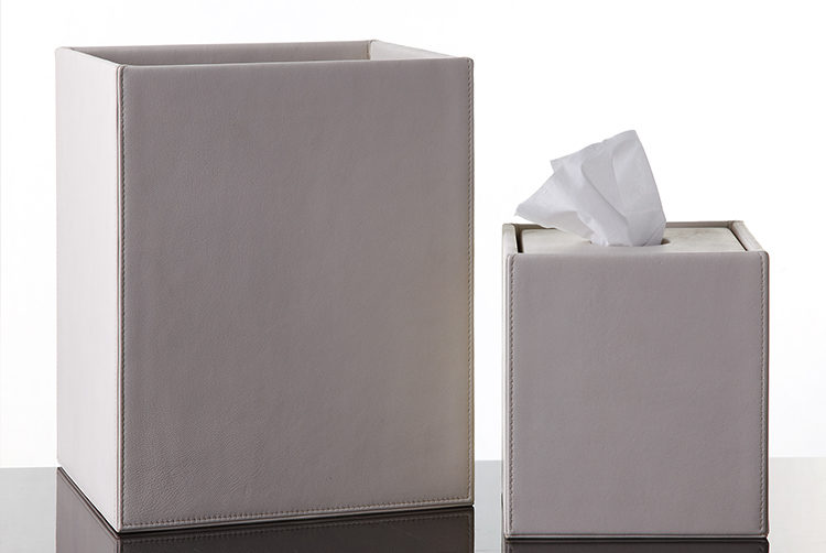 a white leather paper bin and tissue box