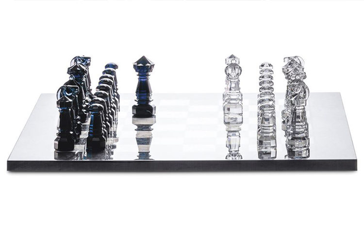 a showstopping chess set with dark blue and white crystal chess pieces
