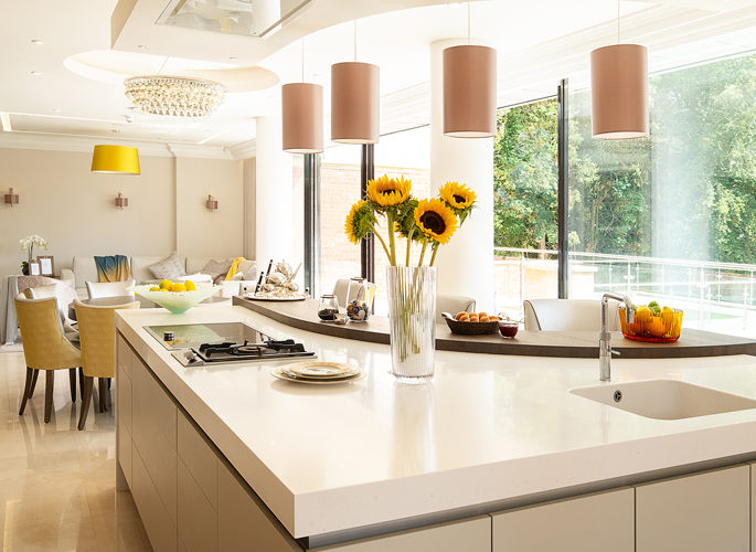 an open plan kitchen with accessories on the counter and yellow decor