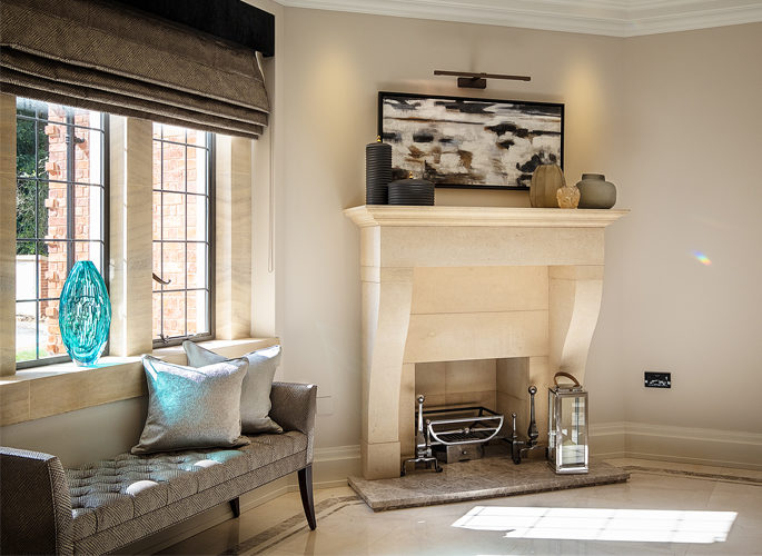 fireplace with decorative accessories and hurricane lamps