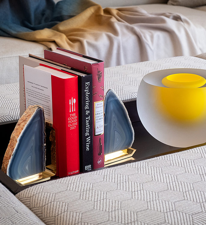 book ends made from precious stone and a yellow crystal contemporary case on a table