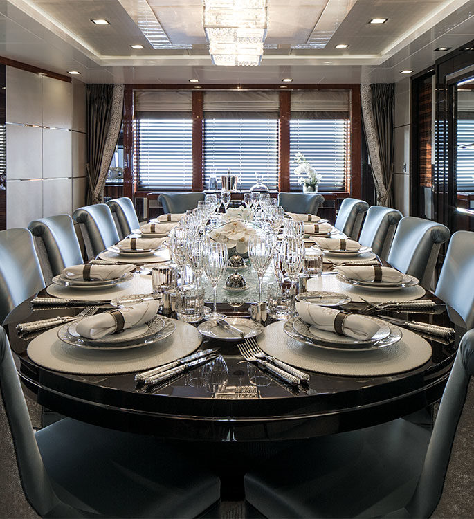 A luxury dining setting on a superyacht