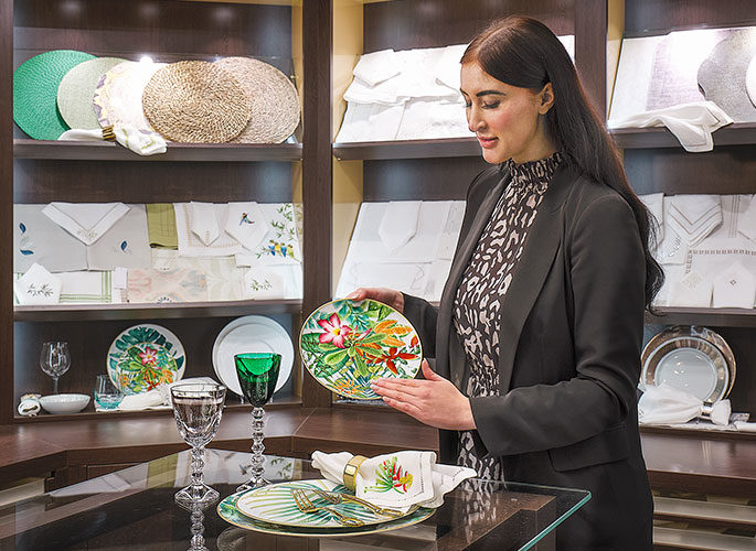 Projects Team showcasing a matching tableware set in the Glancy Fawcett Table Linen Showroom