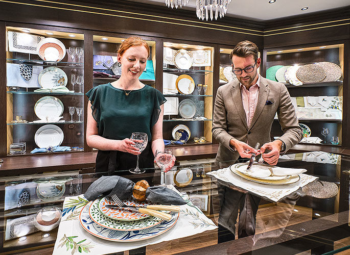 The Projects Team showcasing tableware settings to a client in the Glancy Fawcett Table Linen Showroom