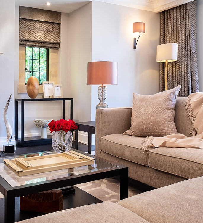 a neutral sitting room interior with luxury accessories