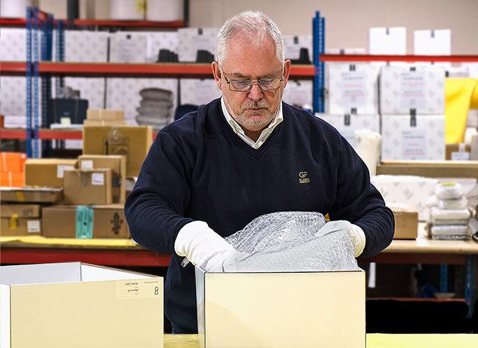 Logistics team carefully packing luxury product