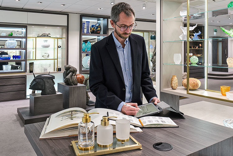 Design Team working on a bathroom accessory design in the Glancy Fawcett Showroom with a client