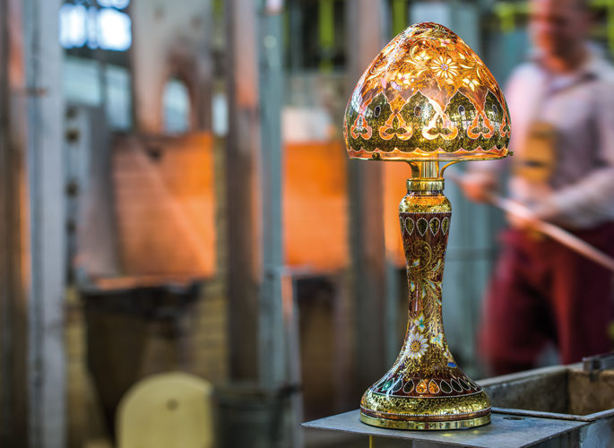 an artisan craftsman making crystal lamps from scratch in a kiln