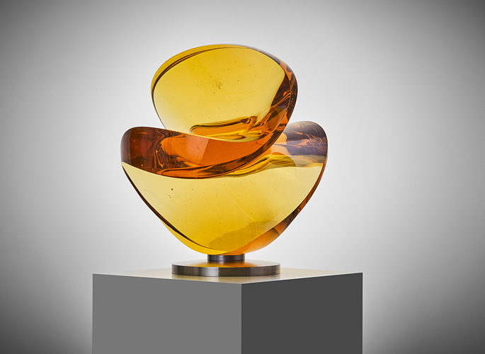 an abstract amber crystal art sculpture with curved features